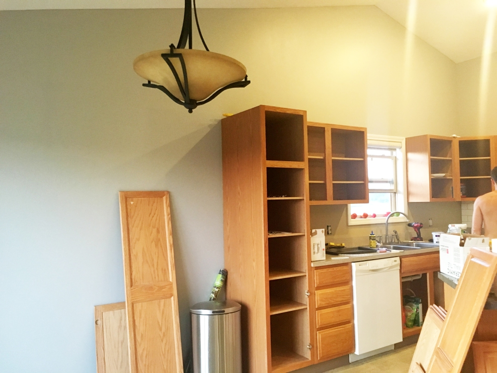 Before photo of our kitchen renovation. Featuring oak cabinets.