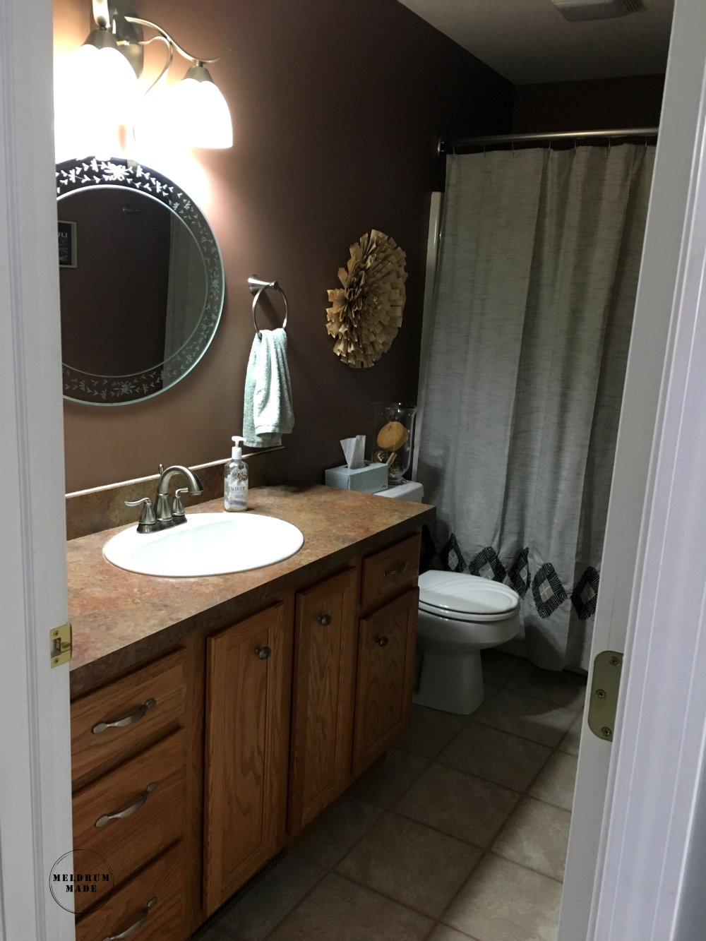 Our main floor bathroom before the weekend reno! Flip to include painted cabinets, fresh wall color, subway tile, and a new countertop.