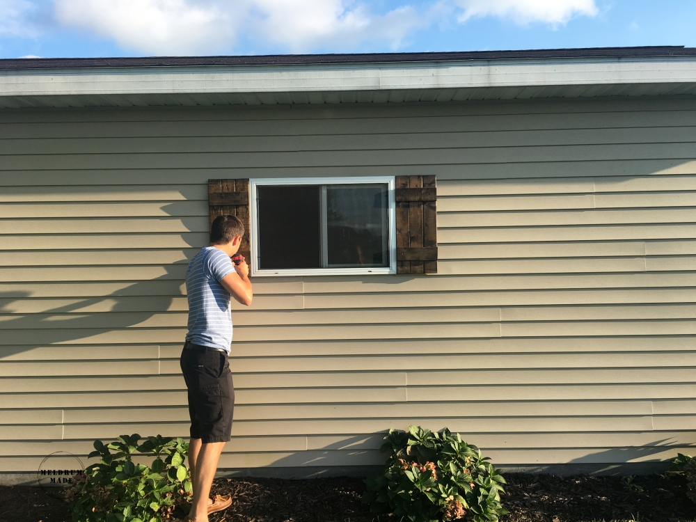 Hanging our board and batten shutters.