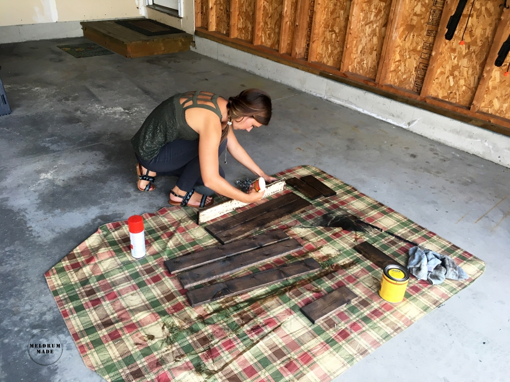 Securing the wood pieces with wood glue - building our board and batten shutters.