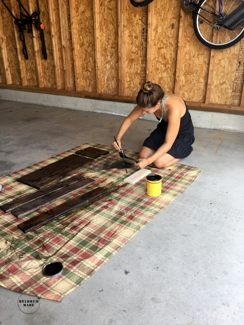 Staining the pieces for our board and batten shutters.