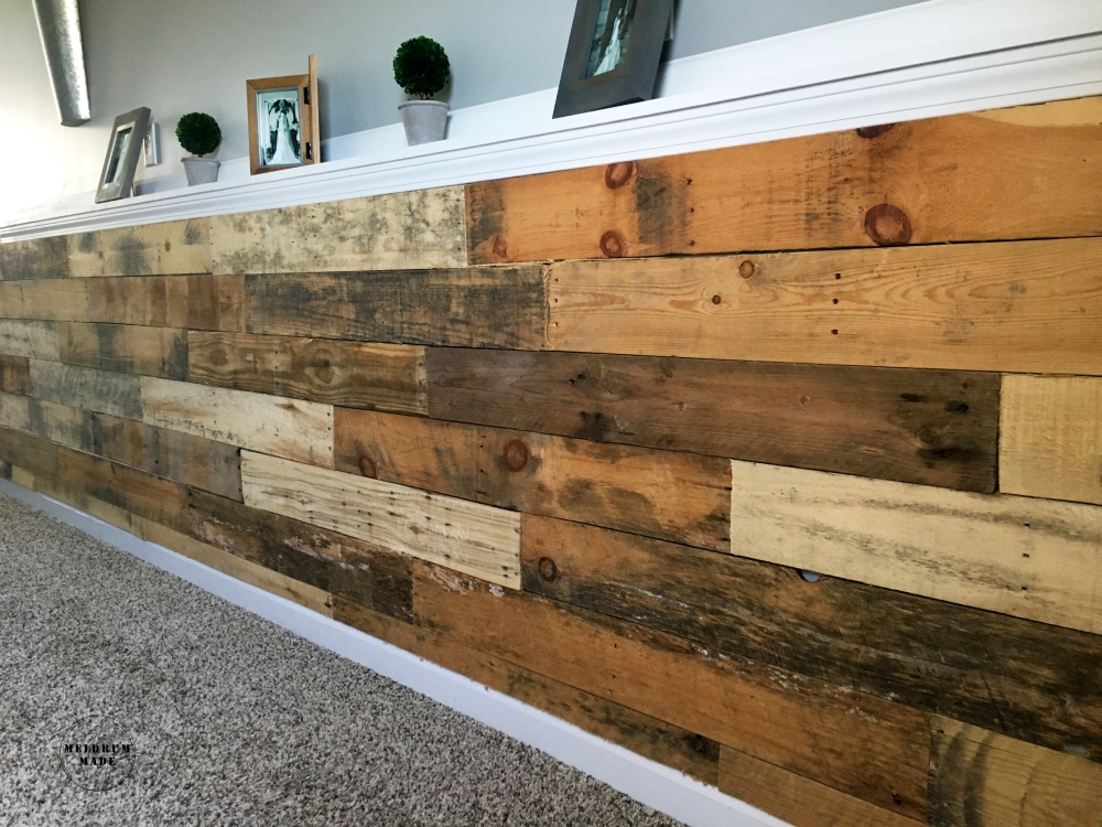 DIY Pallet Wall Tutorial - project completed for under $40! Rustic pallet pieces add texture and dimension to this space.