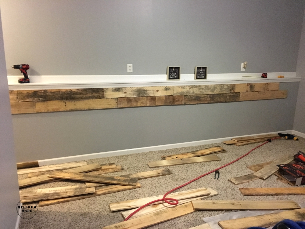 DIY Pallet Wall Tutorial - Arranging the pallets to plan the design.