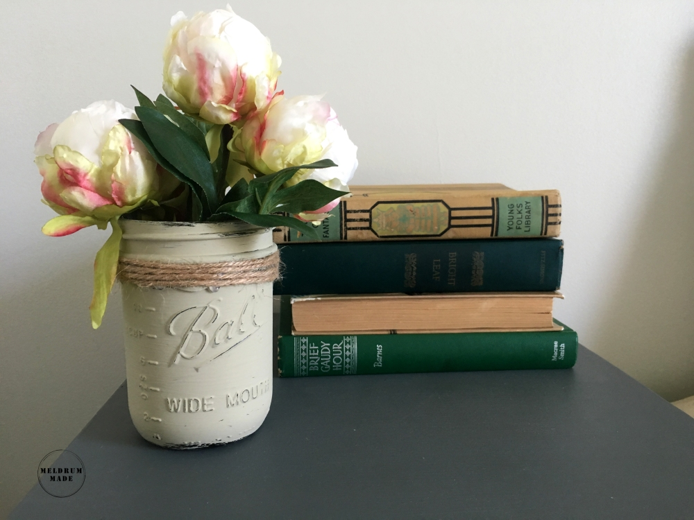 Guest room decor update - featuring antique books, mason jar vases, and peonies.
