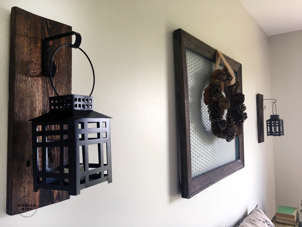Lantern sconce and Natural Pinecone Wreath- hanging lantern, walnut stain, pallet wood - available on Meldrum Made's Etsy store.