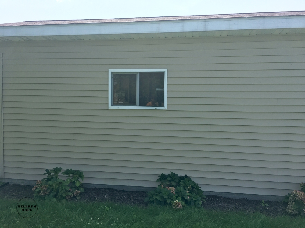 Before shot of our drab garage window - before building the board and batten shutters.