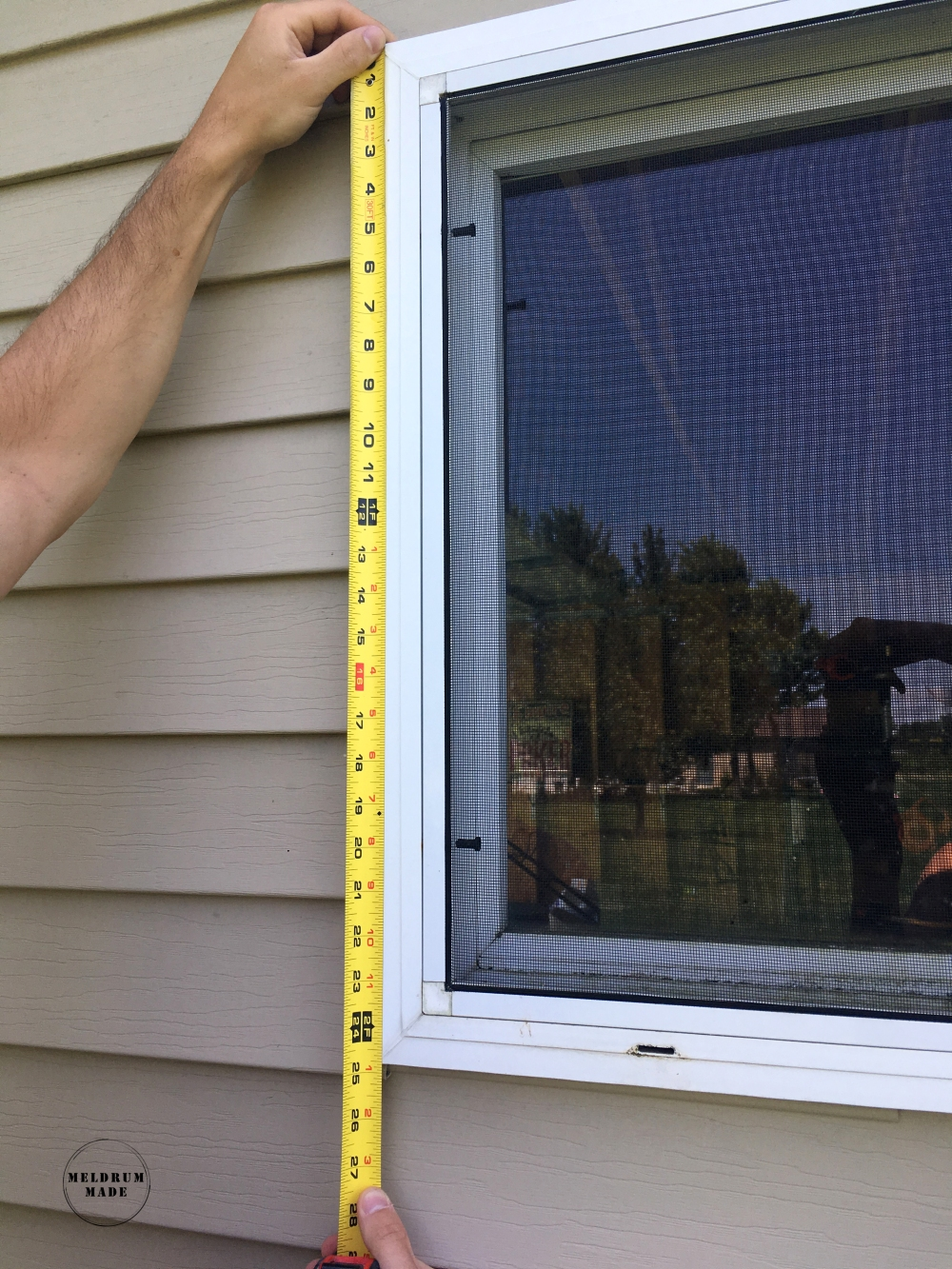 Measuring the window to build the board and batten shutters - we decided to custom build them to fit the entire height of the frame.
