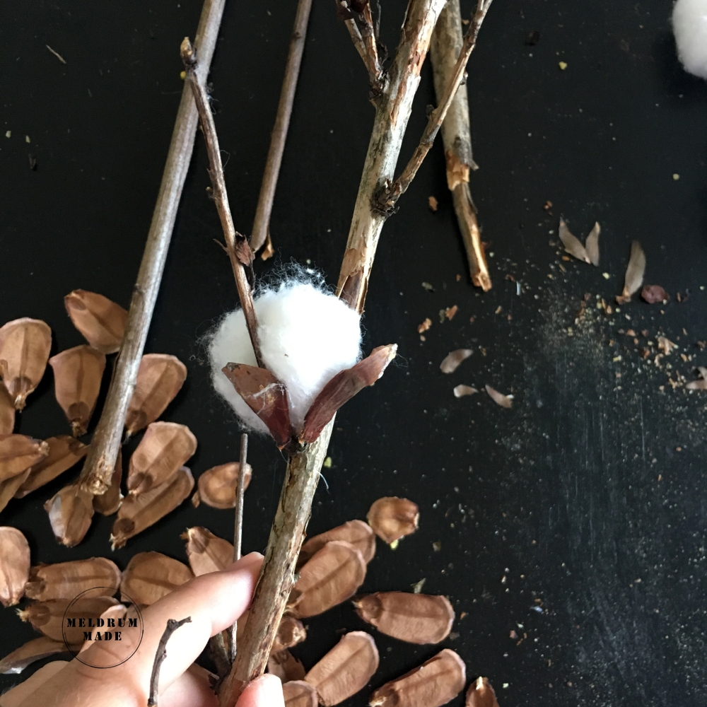 DIY Cotton Stems - attaching store-bought cotton balls to branches with hot glue.